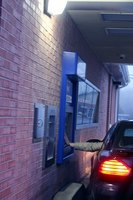 A bank cashier may also be responsible for a drive through window.
