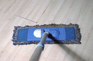 Use a mop to help restore your linoleum's original white.