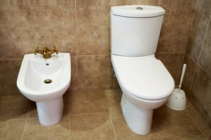 Remove mineral deposits on a toilet regularly to prevent them from building up.