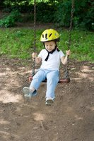 Child on a swing.