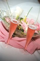 A pink-and-black party design is enhanced with pink flowers and drinks.