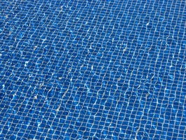 Remove stains from vinyl pool liners when they occur.