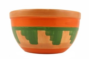 Create fun designs on pottery using homemade paint pens.