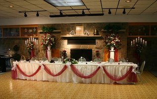 A long, rectangular head table setting is traditional at a wedding.