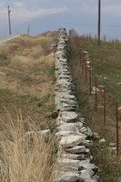 Outline your garden, yard or property with a beautiful, natural stone wall.