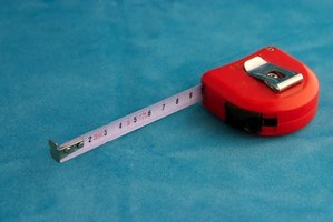 A measuring tape provides precision when estimating carpeting needs.