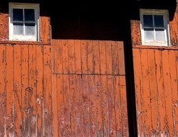 Keep sliding barn doors lubricated for best operation.