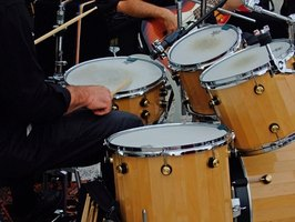 Electronic Drum kits use sampled recordings of real drum kits.
