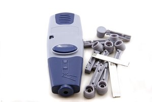 A lancet device like this is used with the FreeStyle Lite blood glucose monitor.