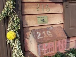 Enhance a plain mailbox with festive decor items.