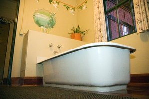Refinishing an old bathtub involves spraying a new glaze over an existing tub.