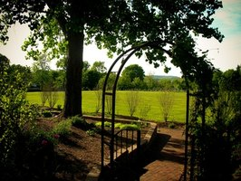 An arbor is a perfect touch for this shaded garden.