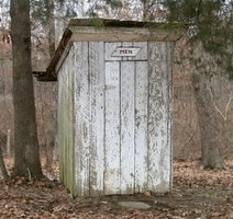 A outhouse in the woods
