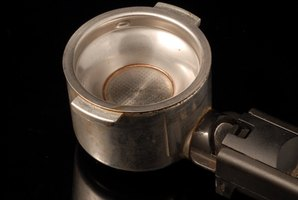 The portafilter quickly accumulates coffee residue, and should be cleaned regularly.