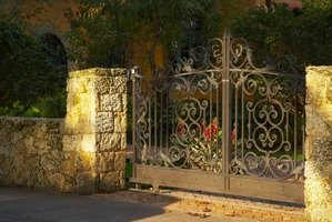 Patch and paint an iron gate.