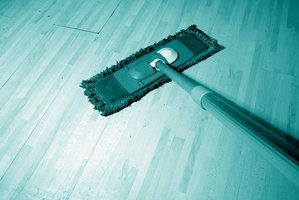 Clean laminate safely with a vinegar-based spray and a dry mop.