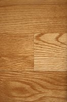 Remove scratches from laminate flooring with wood putty.