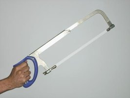 A hacksaw can be used to cut plastic conduit, but a PVC cutter is the preferred tool.