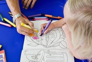 Give kids a place to color, then use the drawings to decorate the office.