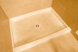 Adhesives can ruin the appearance of fiberglass shower pans.