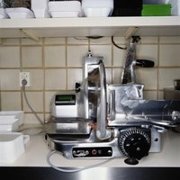 Use care to operate a meat slicer safely.