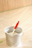 Scrape carefully when removing paint from the edges of trim and countertops.