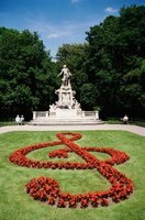 These red flowers are planted in the shape of the treble clef.