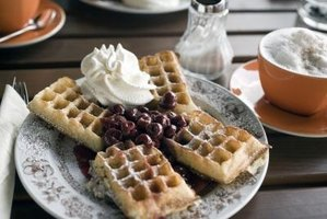 Dress up your waffles with flavored syrups and whipped cream.