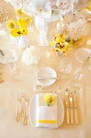 A child can learn how to set up a table place setting.