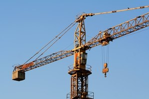 Crane operators frequently work high above the ground on construction projects.