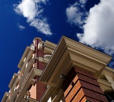 A cornice is a decorative molding element found at the top of building walls.