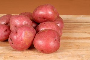 Choose evenly sized, smooth potatoes for grilling.