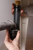 A plumber's auger is inexpensive and can help you clear deeper clogs.