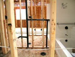 A shower enclosure above a tub gives homeowners the option of having a bath or a shower.