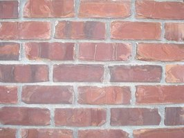 Paint a brick pattern to create a simple yet intriguing piece of artwork.