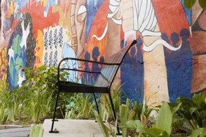 Paint a mural to cover an unsightly outdoor wall.