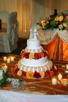 Decorate a white cake with orange flowers.