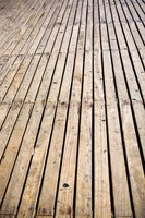 Bleach wood decks to remove mold, bacteria and other contaminates.