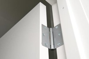 Failing to loosen door hinges properly can strip the screw holes.