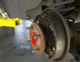 You will need to raise your vehicle and remove the wheel in order to access the wheel bearings.