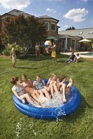 When the kiddie pool gets too crowded, make a temporary wading pool in the backyard.