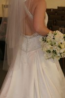 Keep your wedding dress looking beautiful with a bustle.