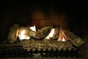 Gas fireplaces use realistic-looking concrete logs to simulate a wood fire.