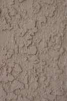 The textured surface of stucco requires a heavy application of paint.