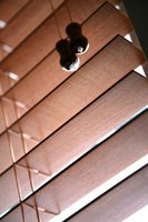 Wood blinds shouldn't be difficult to remove if installed properly.
