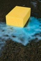 A sponge and liquid detergent remove debris from carbon filters.