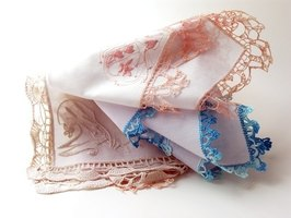 Use antique handkerchiefs in different colors and designs to a make a unique window valance.