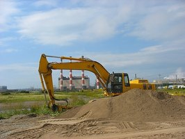 Hydraulic cylinders power the arm of construction vehicles.