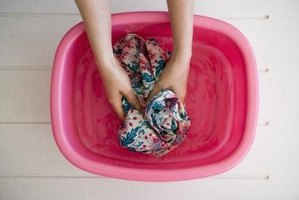 Soaking the stain in a cleaning solution helps remove it.