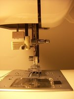 The timing of the feed motion will affect the stitching on a sewing machine.